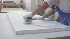 Worker using a power sander to smooth part of the doors frame. Stock Footage