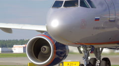 Airplane with view to engines and landing gears Stock Footage
