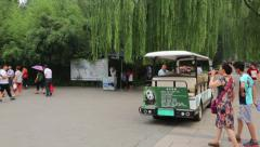 Visitors at the entrance to the cage with the Giant Panda at the Beijing Zoo Stock Footage