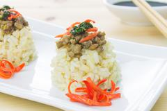 Rice Topped with Stir-Fried Pork and Basil Close Up - stock photo