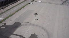 Aerial of Black Car Driving Around Test Track wet Stock Footage