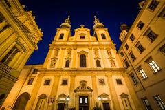 The Jesuit Church at night, in the Inner Stadt, Vienna, Austria. - stock photo