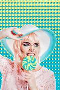 Girl with makeup in style of pop art, hat and lollipop. Colored background. - stock photo