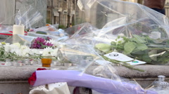 Flowers, candles, notes in tribute to victims terrorist attacks 13/11 Paris 10 Stock Footage