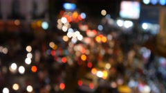 busy city centre traffic intersection night lights out of focus bokeh 4k - stock footage
