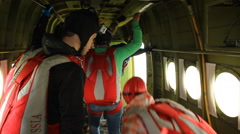 The athletes paratroopers out of the small plane to make the leap. Stock Footage