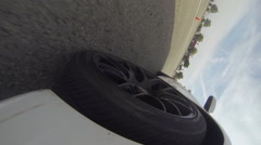 GoPro Car Wheel with Black Rims Stock Footage