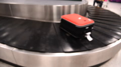 Blurred luggage passing by while on baggage carousel Stock Footage