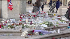 Flowers, candles, notes in tribute to victims terrorist attacks 13/11 in Paris 9 Stock Footage