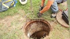 Extracting Water From Hole in Ground Stock Footage