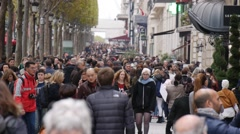 Slow motion shots of crowds of people walking down Champs-Élysée. Stock Footage
