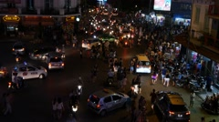 busy city traffic time lapse night lights crowd cars people chaos 4k - stock footage