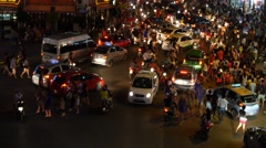 busy city centre traffic intersection night lights crowd cars people chaos 4k - stock footage