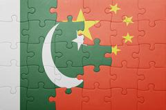 puzzle with the national flag of china and pakistan - stock illustration