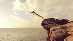 Cliff Jumping at Sunset. Summer Extreme Sports Cliff Jumping Outdoor Lifestyl Stock Footage