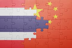 Stock Illustration of puzzle with the national flag of china and thailand