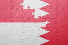 Stock Illustration of puzzle with the national flag of bahrain and indonesia