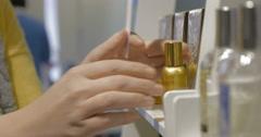 Perfume spraying by beautiful girl hands Stock Footage