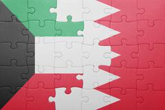 puzzle with the national flag of bahrain and kuwait - stock illustration