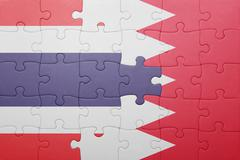 Stock Illustration of puzzle with the national flag of bahrain and thailand