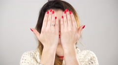 Woman covering face with hands palms 4K. Stock Footage