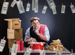 Businessman is laundering money in foam - stock photo