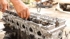 Installation camshaft on cylinder head of engine. Engine overhaul by professiona Stock Footage