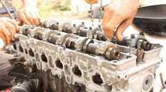 Installation camshaft on cylinder head of engine. Engine overhaul by technician. Stock Footage