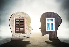 Two silhouettes of human head with windows inside - stock illustration