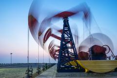 Working oil-rig in oilfield in clear sky Kuvituskuvat