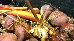 Smoked carrots and golden beets vegetables, in a smoke box Stock Footage