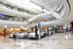 Blur or Defocus Background of Car Sales Gallery in Shopping Center Stock Photos