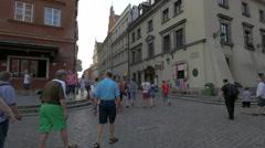 Tourists heading to Swietojanska street, next to Castle Inn, in Warsaw Stock Footage