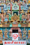 Sculptures on Hindu temple gopura (tower). Jambukeshwarar temple. Madurai, Ta Stock Photos