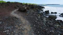 Walking over volcanic rock on winding shore in South Maui, Hawaii. Stock Footage