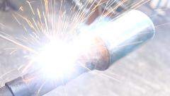 Professional technician is welding the exhaust pipe. Manufacturing and modify ex - stock footage