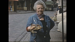 Stock Video Footage of Vintage 16mm film, 1963, Normandy, village fish seafood market