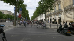 Young people sitting on benches and on ground on Champs-Elysees, Paris Stock Footage
