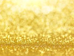 Gold abstract bokeh lights. Stock Photos