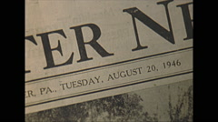 Stock Video Footage of Vintage 16mm film, 1946, Pennsylvania, newspaper headline tornado