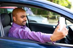 driver taking a selfie in his car - stock photo