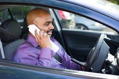Driver parked in a car pari to make a phone call Stock Photos
