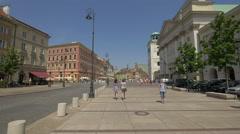 Young women walking on Krakowskie Przedmiescie, heading to Castle Square, Warsaw Stock Footage