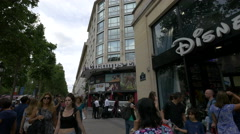 Passing by Disney store and Gaumont Cinema on Avenue des Champs-Elysees, Paris Stock Footage