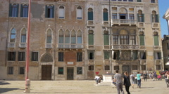 Stock Video Footage of Tourists walking and relaxing in Campo San Maurizio in Venice