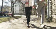 Couple Jogging in Tallinn Streets Stock Footage