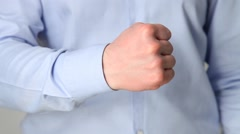 Unrecognizable businessman showing a strong fist Stock Footage