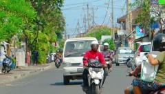 Typical afternoon traffic on city street in Sanur, Bali, Indonesia, with soun Stock Footage