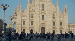 MILAN, ITALY Tourists and residents walking on the central square Stock Footage