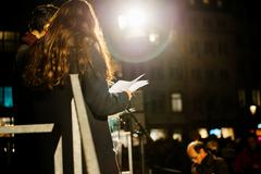 People reading from the stage the names of the victims - stock photo